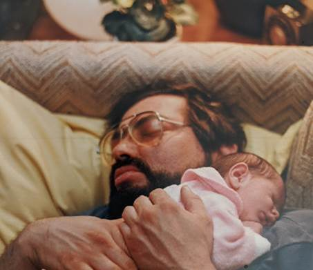 A father holding his baby daughter