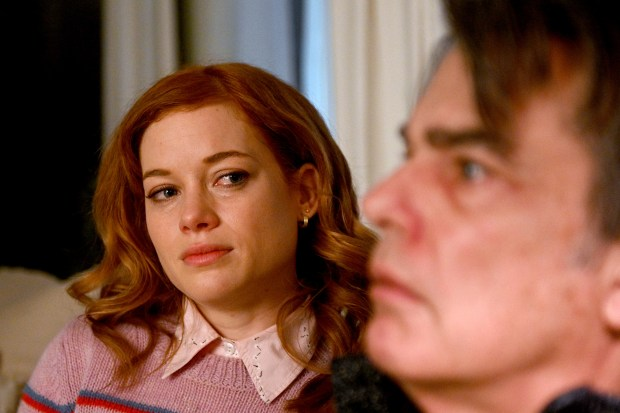 """The character Zoe from """"Zoey's Extraordinary Playlist"""" looking at her father, played by actor Peter Gallagher"""